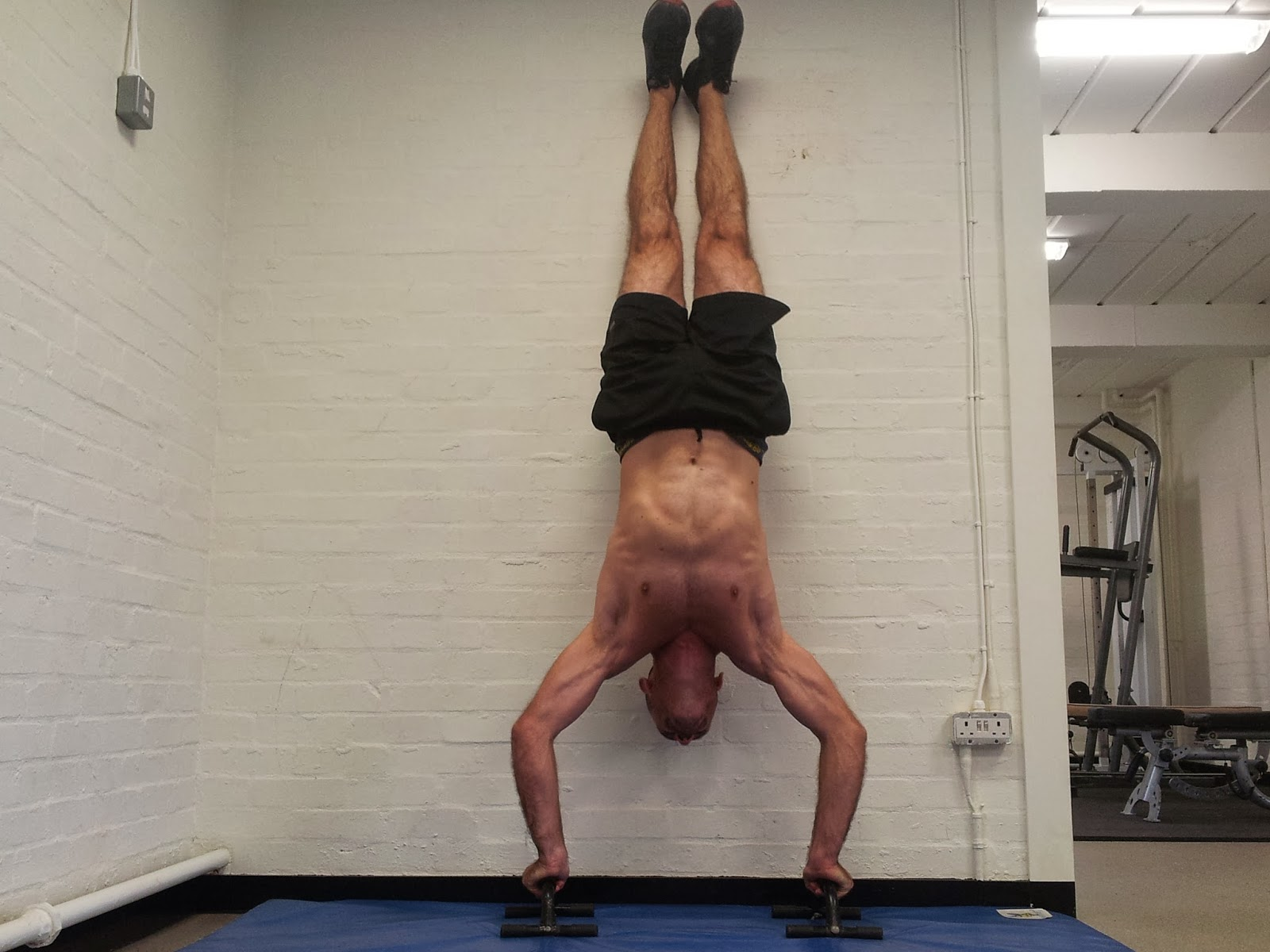 Work Up Handstand Pushup.