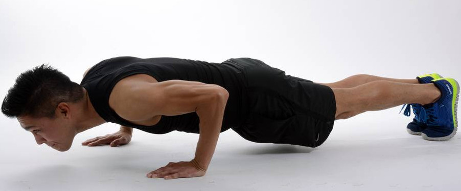 image of a man doing pushups