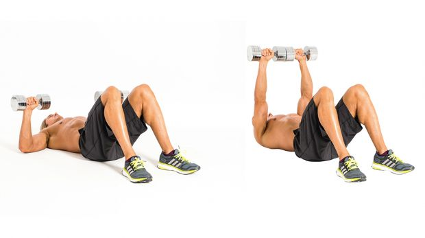 image of a man doing dumbbells chest press on the floor